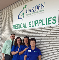Aneesh Lakhani and his pharmacy team