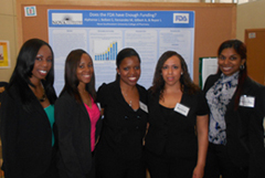 Anishka Gilbert, Judith Alphonse, Lauren Roper, Marlene Fernandez and Sireesha Bellam in front of their poster